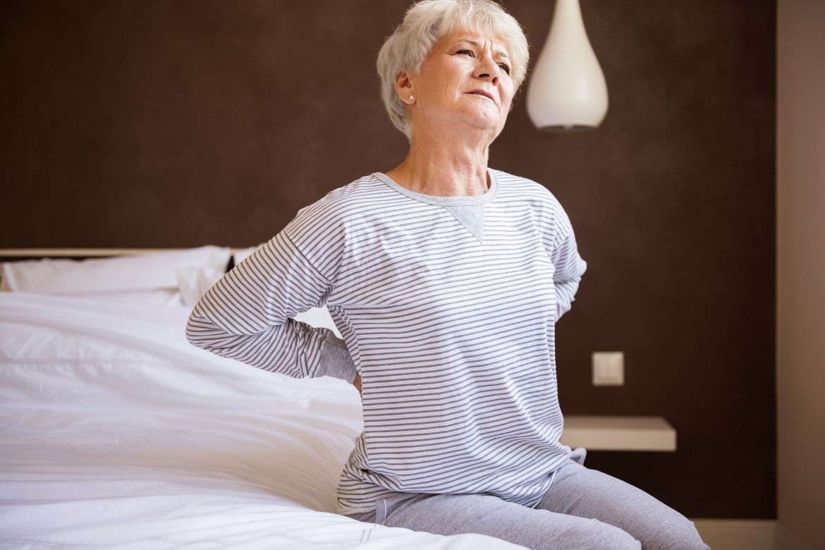 Old woman with back pain